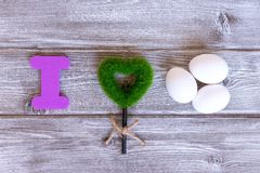 Sign I love eggs made of colorful letters, green grass heart and natural eggs, eco healthy food concept royalty free stock image