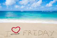 Sign I love Friday. With heart on the sandy beach by the ocean Royalty Free Stock Photos