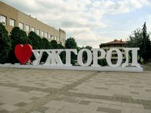 Sign `I love Uzhhorod` on Poshtova Square in Uzhgorod. Ukraine, Uzhhorod - April 30, 2018: Sign `I love Uzhhorod` on Poshtova Square in Uzhgorod. Three-meter stock images