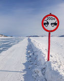 Sign on icy road Royalty Free Stock Images
