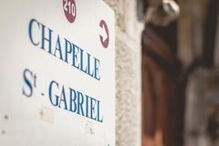 Sign indicates the direction of the chapel Saint GABRIEL. In Lourdes in France Stock Photography