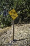 Slide Area Sign. A sign indicating caution is needed due to rock slides royalty free stock photo