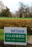 Sign indicating golf course closed for season Stock Photos