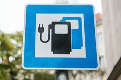 A sign indicating a special place for charging electric vehicles. A modern and eco-friendly mode of transport. stock images