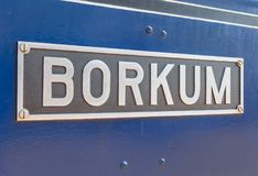 Sign with island name on the steam strain of Borkum. Germany stock photos