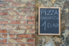 Sign in Italian pizza Margherita to 1 euro.  stock photo