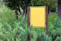 Sign in the jungle. Here is a sign in the jungle without any words, which allow user to put own words on it Royalty Free Stock Photography