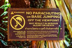 Sign prohibiting parachuting or base jumping from viewpoint in Railay, Krabi, Thailand. stock photography