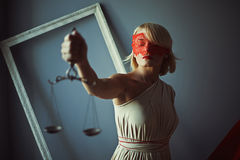 Sign of justice with scales. Sign of justice photo of young woman with scales Royalty Free Stock Photo