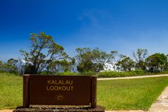 Kalalau Lookout. Sign at the Kalalau Lookout in Kokee State Park into Kalalau Valley at the Na Pali coast on Kauai, Hawaii, USA Royalty Free Stock Photo