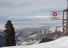 Sign of Karakol ski resort and view on the Issyk Kul lake Royalty Free Stock Photos