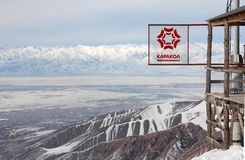 Sign of Karakol ski resort and view on the valley of Issyk Kul l Royalty Free Stock Images