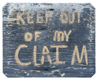 Sign - Keep Out Of My Claim. Keep Out Of My Claim - sign on a weathered board stock image