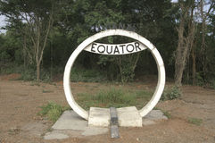 A sign telling people they are on the equator. A sign in Kenya, Africa, telling the people they are on the equator at this point. Many tourists stop at this Stock Photo