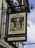 The sign for The Kings Head public house, Warrington, Cheshire,. On the exterior of a mock tudor building Stock Images