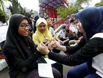 Sign language. Deaf socialized sign language in a public space in the city of Solo, Central Java, Indonesia stock image