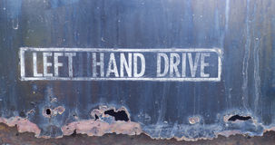 Sign left hand drive Stock Photo