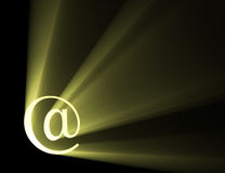 At symbol letter light flare halo. At symbol with powerful sun light halo. Cyber internet background. @ is an abbreviation of the word at or the phrase at the stock illustration