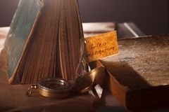 Sign Life is an adventure concept photo with vintage books - Vocation background. royalty free stock images