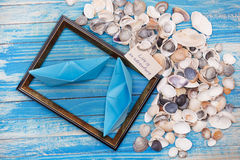 Sign Life is an adventure with shells and photo frame. Vocation background Stock Images