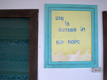 Sign of Life Is Better In Flip Flops, on wall of old house, Nicaragua. Central America stock photography