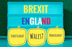 Sign with light inscription in German Brexit, England, Northern Ireland, Wales and Scotland in English Northern Ireland, Scotland,. Wales symbolizing the stock images