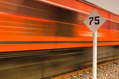 Sign limit speed and train in a fast movement Royalty Free Stock Photos