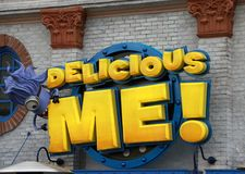 The sign logo of Delicious me in Minion zone at Universal Studios Japan. royalty free stock image