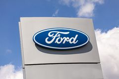 Sign with the logo of Ford Motor Company.  American multinational automaker. That has its main headquarters in Dearborn, Michigan, a suburb of Detroit stock photos