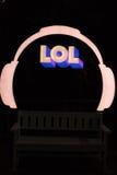 Sign LOL headphones, blue black background night Royalty Free Stock Photography