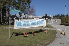 Sign, We Love This Coast, protests the Kinder Morgan pipeline expansion. We Love This Coast banner protests the pipeline expansion outside the front gate of the Royalty Free Stock Photography