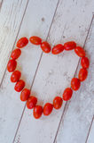 Sign of love. Heart made from small tomatoes stock photos