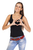 Sign of love and kindness. The sign of love and kindness. Happy brunette woman in black t-shirt, isolated on white background Stock Images