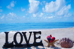 Sign LOVE by the ocean Royalty Free Stock Photo