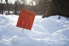 Sign made by children warning about existence of a snow fort. An orange sign made by children warning about the existence of a snow fort Royalty Free Stock Photos