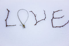 Sign made of wood in the snow. St. Valentine`s Day. Stock Image