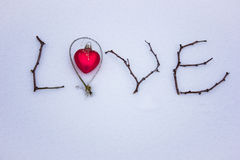 Sign made of wood in the snow. St. Valentine`s Day. Royalty Free Stock Image