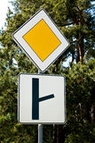 Sign of the main road and a fork Stock Photo