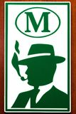 Sign of a male toilet with a silhouette of a man in a hat and smoking pipe. Plastic sign of a male toilet with a green silhouette of a man in a hat with a Stock Image
