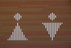 Sign of man and woman on wooden background royalty free stock image
