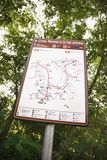 Sign with map showing routes. Royalty Free Stock Image