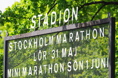 The sign for the marathon event ouside the Stockholm Stadium Stock Photo