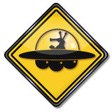 Sign with martian and ufo Stock Image