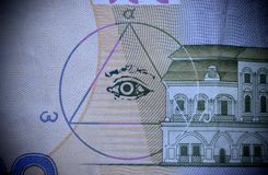 The sign of the Masons all-seeing eye on money. Sign of Masons, all-seeing view of money close-up royalty free stock photos