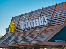 Sign mc donald logo against clear blue sky. Orte, Italy - Dec 2018: sign mc donald logo against clear blue sky royalty free stock photo