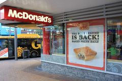 McDonalds storefront with sign for Georgie Meat Pie stock photography