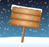 Sign on meadow with falling snow Stock Images