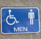 Sign for a Men's Restroom. Blue men's restroom sign on wall outdoors Stock Photo
