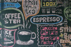 Sign menu coffee and tea. Drawn with colored chalks on a black blackboard Stock Images