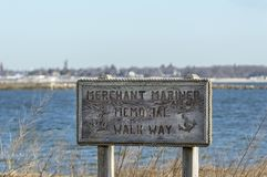 Sign for Merchant Mariner Memorial Walk Way. New Bedford, Massachusetts, USA - March 20, 2018: Worn sign for Merchant Mariner Memorial Walk Way at Fort Taber Royalty Free Stock Photography